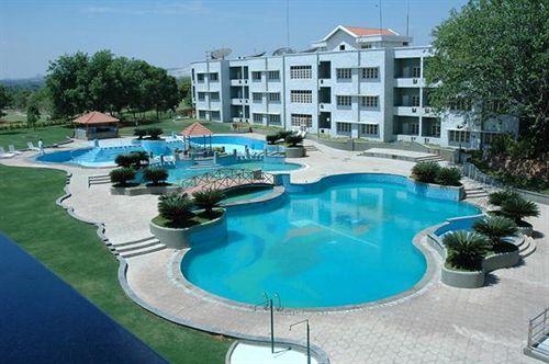 Swimming in Eagleton Golf Resort Bangalore