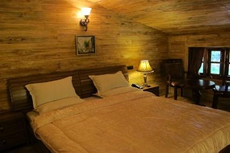 Bedroom in Glyngarth Villa Hotel Ooty